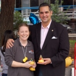 ACCT Philly Executive Director Susan Cosby and Deputy Mayor Richard Negrin get ready to throw the first ducks into the fountain